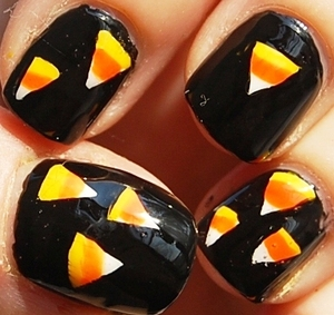 Candy Corn Halloween Nails (Halloween Series #1)  tutoriaL: http://www.youtube.com/watch?v=1fUkXSuxaOo blogpost: http://misstouver.blogspot.com/2011/10/candy-corn-halloween-nails-halloween.html