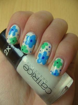 http://arvonka-nails.blogspot.com/2012/04/catrice-snow-motion-flower-nail-art.html