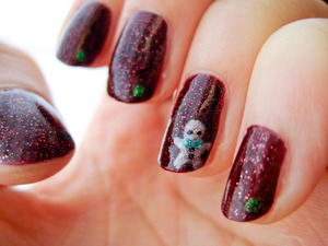 My holiday nails. Featuring a special guest: a gingerbread man.