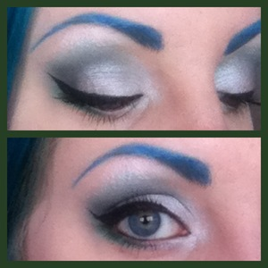 A smokey eye created with silver, white and green eyeshadows - unfortunately my camera phone doesn't pick up colours too great at times :(
