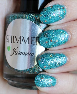 See my in-depth review & more swatches: http://www.swatchandlearn.com/shimmer-jasmine-swatches-review-layered-over-adorn-age-of-aquarius/