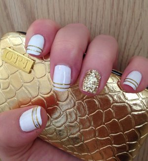OPI nail polish, gold striping tape and gold sparkle dust