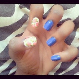 i love Essies - Butler Please polish :] its such a gorgeous blue, paried it with some pink roses on white