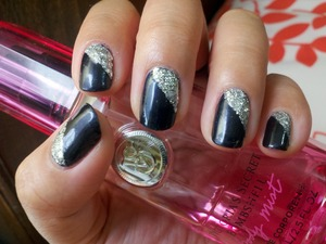 A sophisticated look using OPI Light My Sapphire with a coat of OPI Crown Me Already! for added bling.