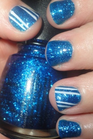 China Glaze Dorothy Who? + L.A. Colors Art Deco in White = Blue Candy Canes! Inspired by my Christmas tree 2 years ago=D