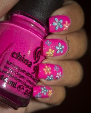 http://www.bellezzabee.com/2013/03/nail-challenge-day-4-pink-flower-power.html
