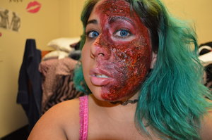 This is a burn make-up done with the help of Gore&Glamour's Gore Basics: Burns YouTube Make-up tutorial. Additional make-up items besides red and brown shadow are liquid latex, stage blood, and lube.