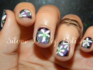 Nail art inspired by the Purple Shamrock.