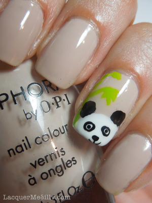 Simple panda accent nail created with a nail art brush and dotting tools.