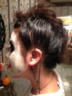 I did this Day of the Dead Mohawk hairstyle to my sister for Halloween.