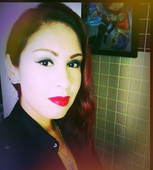 Green eye shadow and red lips are my current favorite combo.  Great for redheads.