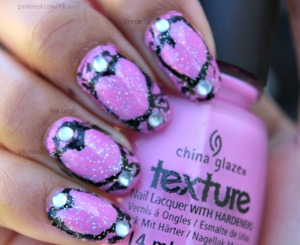 The only nail polishes I used for this was China Glaze Unrefined & Orly Shine On Crazy Diamond. I free handed the heart and the cheetah print in the background using black acrylic paint, and the silver rhinestones I used are by bundlemonster.