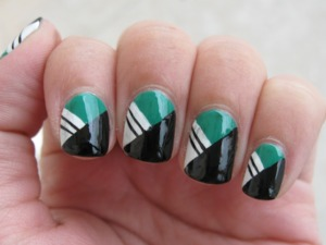 Simple geometric pattern. The black smudged a bit when I put on my top coat. The green is Palm Green by L.A. Colors.