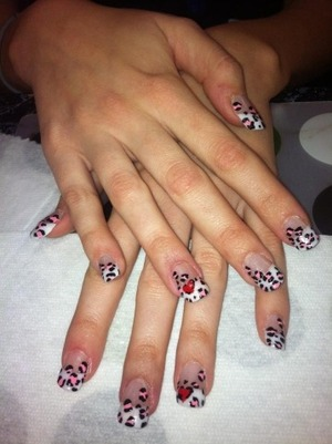 Acrylic nails with leopard print design