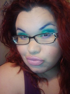 Purple glittery brows with a under the sea look =]]