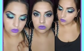 maquillaje turquesa y morado con glitter