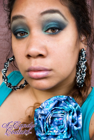 Using ICC's Pressed Mineral Eye Shadow in Silk Sheets, ICC's Pigment in New Moon, ICC's Quads in Chocolate Kisses and Green Apple. ICC Gel Eye liner Duo in Black Out and Cocoa Nut Lipgloss over Revlon lip butter in Cupcake.  Earrings are also by I-Candy Couture.