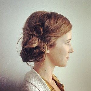 This bride wanted a new spin on the chignon.  With loose curled ends softly placed around the bun and pin curls tucked in just the right places, this updo is past meets present with a new take on a traditional style.