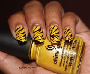 http://www.bellezzabee.com/2012/10/nail-challenge-day-25-inspired-by.html