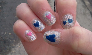 """The multi-coloured silver base is H&M's """"Jo is in the House"""", the blue hearts is also an H&M nail polish called """"Something Blue"""" and the pink one is from the L.A Color craze nail color polish set called """"Summertime""""."""
