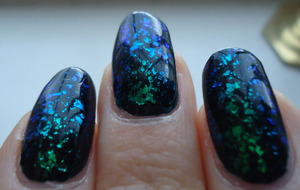 the base color is a dark teal. after glitter application, it reflects blue/green depending on the light! i used 2 coats of each polish like the package suggested, but you can get away with one coat of the teal if you apply it evenly.