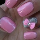 Barbie pink nails with bow accent nail.