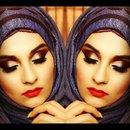 Burgundy makeup look.witj bright orange lip