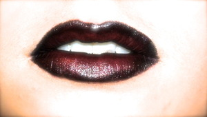 A very easy lip look- I applied black cream eyeshadow with sparkle over the lip area, then I went over it with a deep purple/wine colour and then I added red to the inner portion of the lip, keeping the border.
