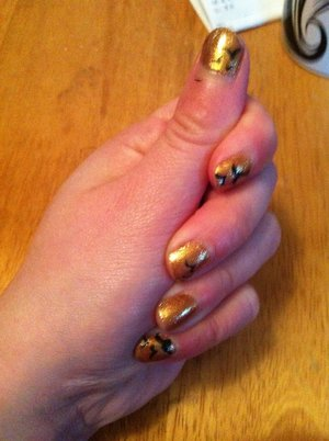 Golden Bird Nails