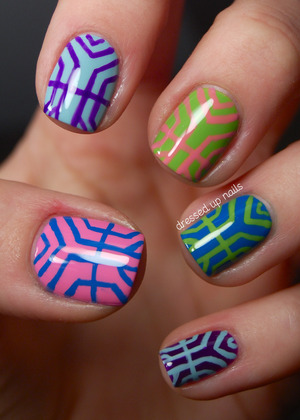 Freehanded these with a mid-length striper brush. Blog post lists colors used as well as more pictures & stuff!  http://www.dressedupnails.com/2013/01/the-digit-al-dozen-does-art-day-1-art.html