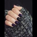 Dark purple n one black nail