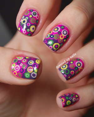 These are kind of insane and I love them. I'm doing a geometric challenge right now and the theme for today is round so I did these!  http://www.dressedupnails.com/2013/02/geometric-challenge-day-2-round.html