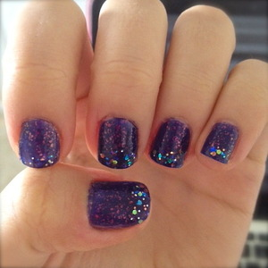 adorable glitter nails for new years eve! purple glitter polish with an extra sparkly tip!