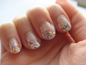milky nail with multi glitter tips