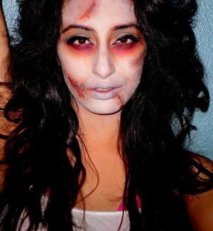 $1 White paint, Coastal Scents, fake blood, and creepy skin.