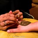 Applying henna at a bridal party.
