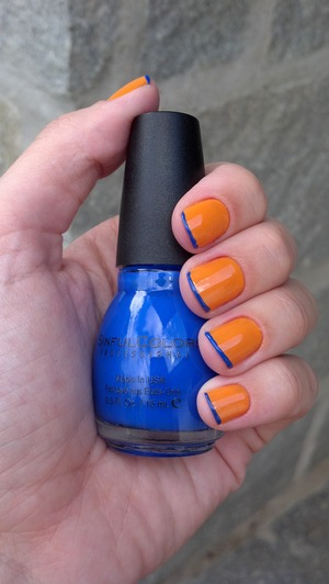 Pale orange with a blue french tip.