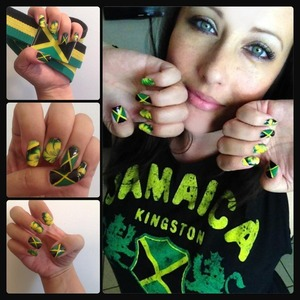 """I used various techniques to create these nails. I painted the Jamaican flag on the ring and thumb fingers and marbled the rest!   """"Here comes dat Jamaican dawta, De gal jus' a chat Patois, ey.""""  ~Eek-A-Mouse"""