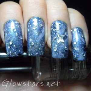 To find out how this look was achieved please visit http://glowstars.net/lacquer-obsession/2012/09/30-days-of-untrieds-galaxy-nails