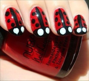 Nail tutorial & more photos here: http://www.swatchandlearn.com/nail-art-tutorial-ladybug-nails/