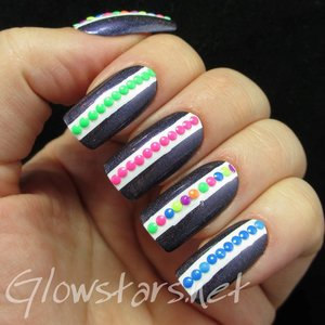 Read the blog post at http://glowstars.net/lacquer-obsession/2015/01/holo-with-neon-stud-stripes/