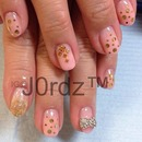 Nude pink with gold and studs nails