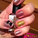 Glitter pink with black bow and a gold ring finger with real glitter