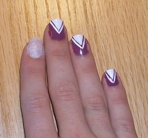 Retake on my Arrowhead Nails from July! Breakdown and much more fabulousness at my blog,  http://rivuletsbeauty.blogspot.com/2011/09/notd-arrowheads-and-fairy-dust.html