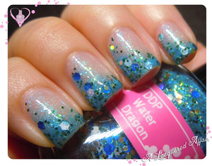 A mani for World Water Day on 22 March, 2013. Horizontal glitter gradient of Darling Diva Polish Water Dragon over the sheer Girly Bits Cosmic Ocean. http://www.alacqueredaffair.com/World-Water-Day-2013-28764226