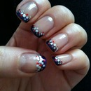 Blue French manicure with red and silver dots