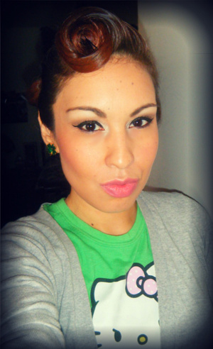 St Patricks Day 2012. Retro hair do' I learned from Iris (IloveGerardo) on Youtube :)  Revlon lip butter in strawberry shortcake  and creme brulee (layered the two)