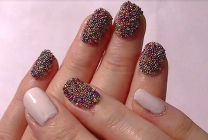 A messy design, but deceptively simple to do. How you girls are enjoying the Caviar nail craze!