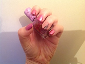 Pink glitter nails with baby pink nail finger with leopard print detail