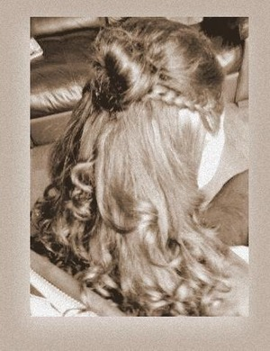 Braided sides' back combed half head' rose bun and curled